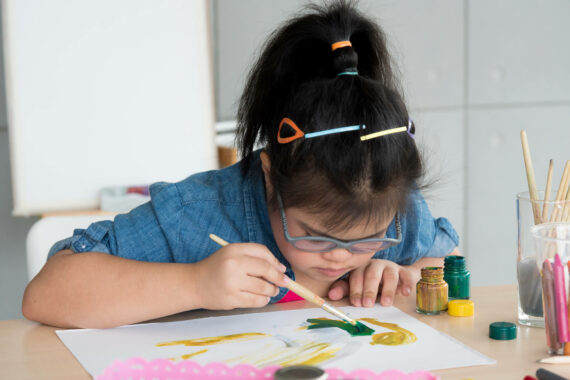 child with learning disabilities painting