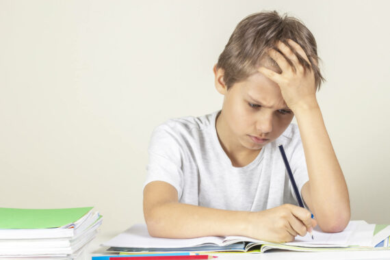 child struggling with dyslexia at school